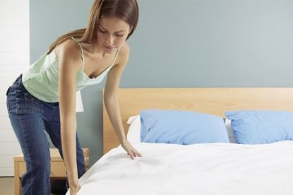 102910203_454292woman_makes_bed[1]