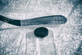 32382189-Hockey-Stick-and-Puck-on-the-Ice-Rink--Stock-Photo[1]
