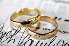 rings on wedding booklet