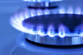 Blue gas flame on the hob close up