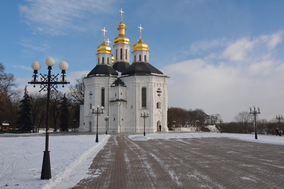 St. Catherine church in winter Chernihiv park with the alley in winter