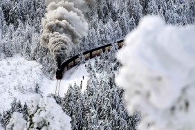 DEEMBER 8: A train on a narrow-gauge railway line makes its way through the winter landscape near Wernigerode, Germany. (Jens Schlueter/dapd)