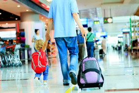 child-travel-accompanied-by-father