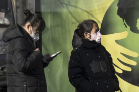 BEIJING, CHINA - FEBRUARY 01 : People, wearing masks, wait at a bus station in Beijing, China on February 01, 2020. ( Stringer - Anadolu Agency )