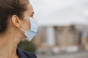 sideways-woman-with-medical-mask-with-copy-space_23-2148767521