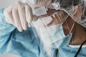 doctor-wearing-protective-equipment_23-2148847212