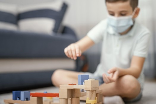 stay-indoors-kid-playing-with-toys_23-2148847296
