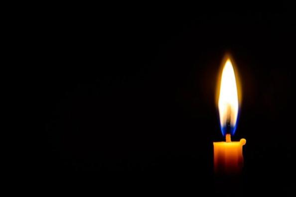 depositphotos_59720475-stock-photo-candle-light-in-the-dark