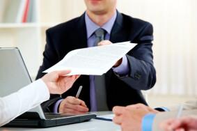 depositphotos_11243510-stock-photo-handing-over-documents