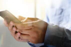 man-holding-en-hands-and-using-digital-tablet-mobile-phone-telephone_36325-2144-1