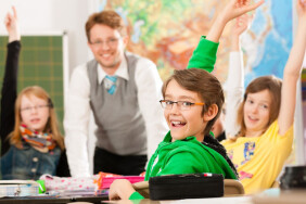 Education - Pupils and teacher learning at elementary or primary school in the classroom